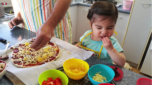 cooking pizza family